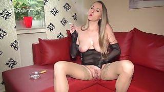 German milf Natalie smoking and playing with the brush pussy on the couch