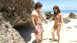 Japanese wife Rio Fujisaki drops unaffected by her knees regarding suck a dick by the sea